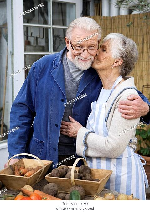 An elderly Scandinavian couple with vegetables in front of them Sweden