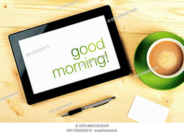 Good Morning Message on Tablet Computer Screen on Office Table