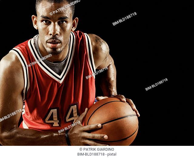 African basketball player holding basketball