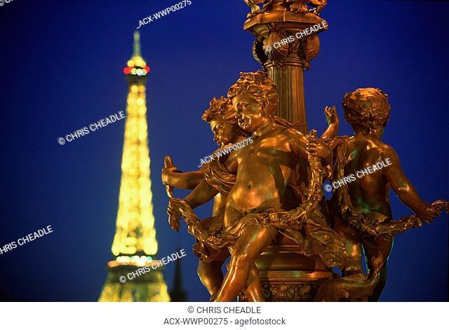 France, Paris - AlexandreIII bridge and Eiffel Tower at dusk