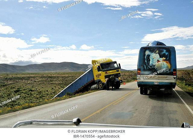 Accident on a highway and buses with a religious picture, Jesus as Lord of the world, Bolivian Altiplano highlands, Departamento Oruro, Bolivia, South America