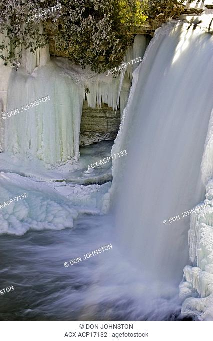 Detail of ice formations and the flowing water of Bridal Veil Falls. Kagawong, Manitoulin Island, Ontario, Canada