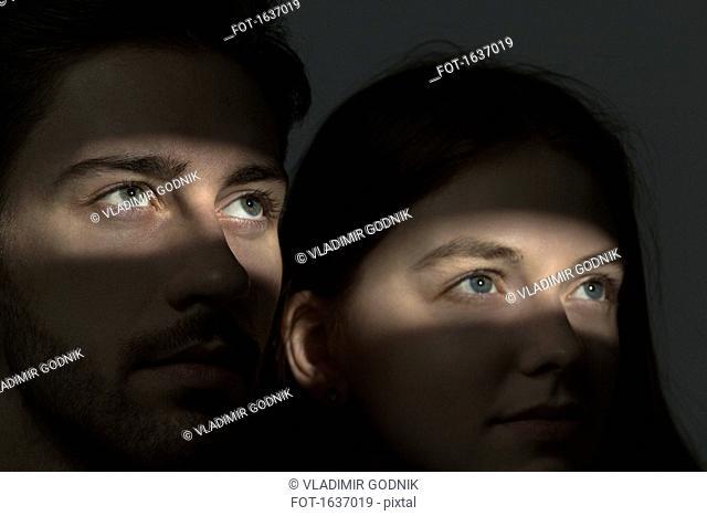Light falling on couple's eyes in dark