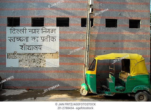 Colourful parked rickshaw in Delhi, India
