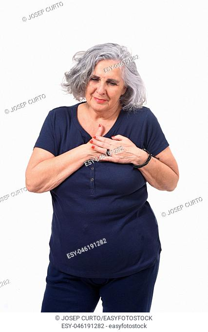 woman with hand to the heart for a scare