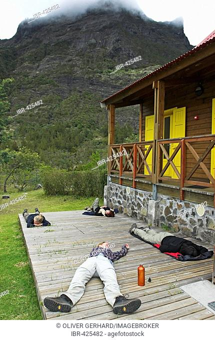 Exhausted hikers in Marla, caldera Cirque de Mafate, La Reunion Island, France, Africa
