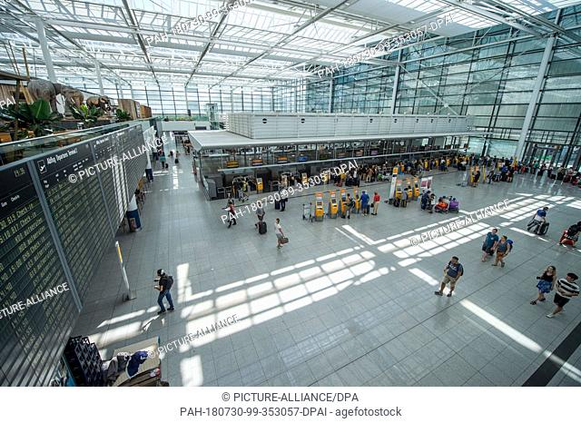 30 July 2018, Munich, Germany: View into Terminal 2 of the airport. After a chaotic weekend, the authorities want to solve the serious breakdown at a security...