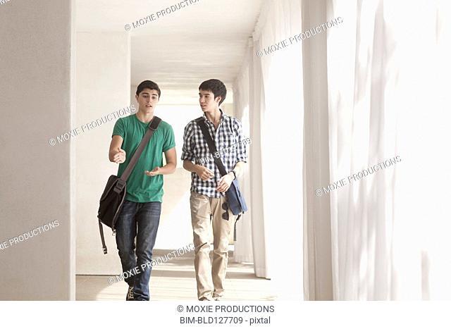 Teenage boys talking in corridor