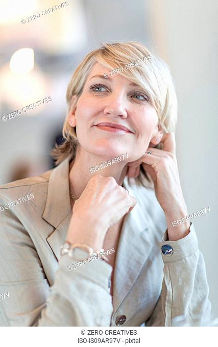 Portrait of mature businesswoman looking up