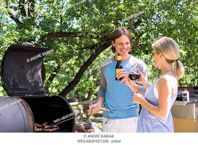 USA, Texas, Couple at barbecue