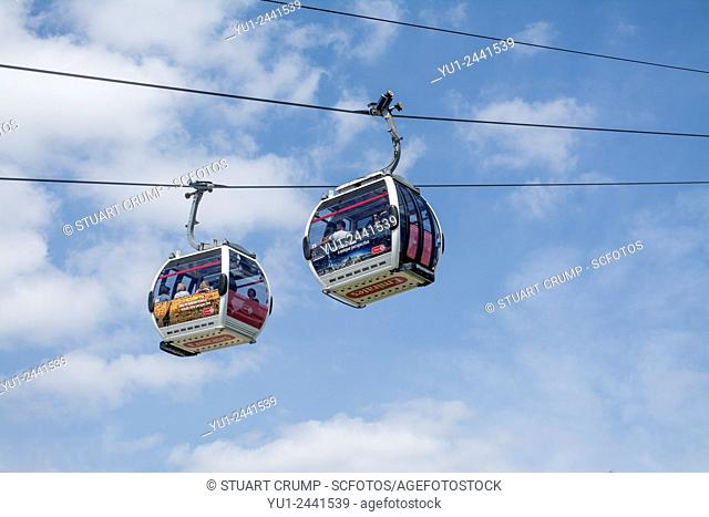 Two Gondolas, Emirates Air Line, a cable car link across the River Thames in London, built by Doppelmayr, England, UK