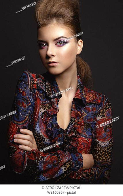 Studio Portrait of a beautiful young model girl with glamorous evening makeup