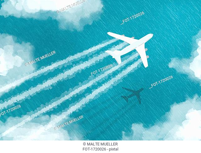 Aerial view of airplane flying over sea