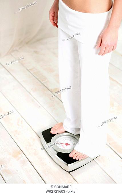 female, legs, scale, standing, fresh, white, cut o