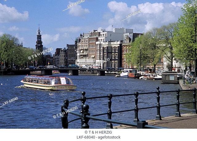Excursion boat on Binnenamstel in front of Munttoren, Amsterdam, Netherlands, Europe