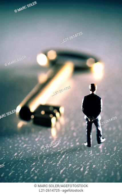 Business concept. Business man looking for a key idea