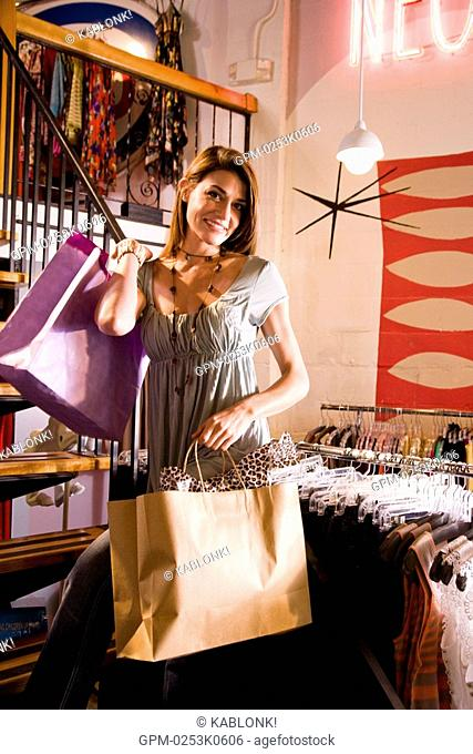 Portrait of a young woman shopping in a clothing store