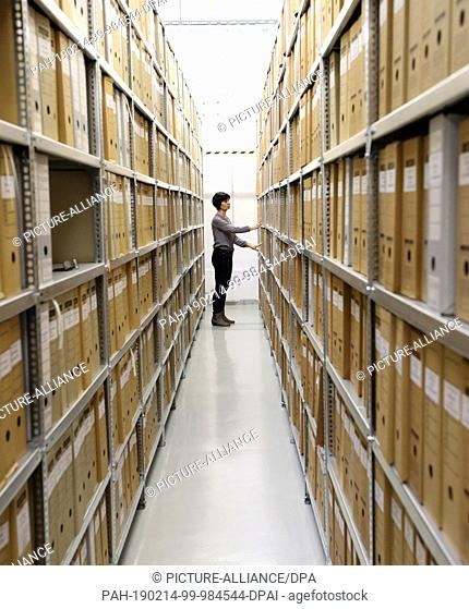 05 February 2019, Mecklenburg-Western Pomerania, Neubrandenburg: Heike Thieme, head of the archive in the Neubrandenburg branch of the authority of the Federal...