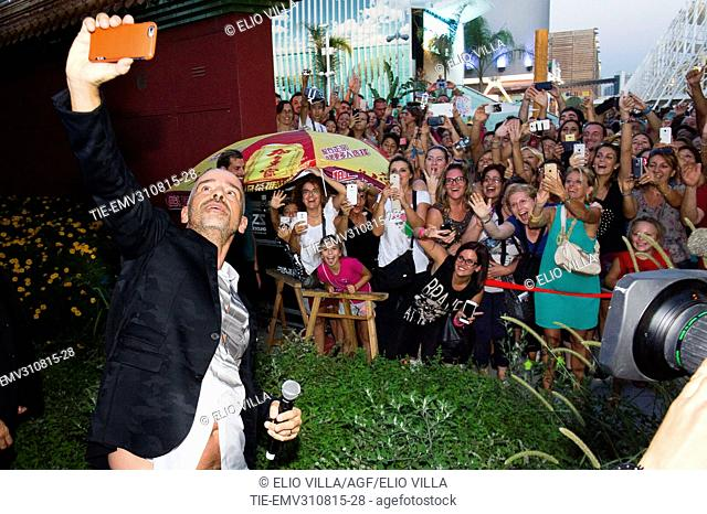 Eros Ramazzotti does selfie with the fans at Milan Expo 2015, Milan, ITALY-28-08-2015