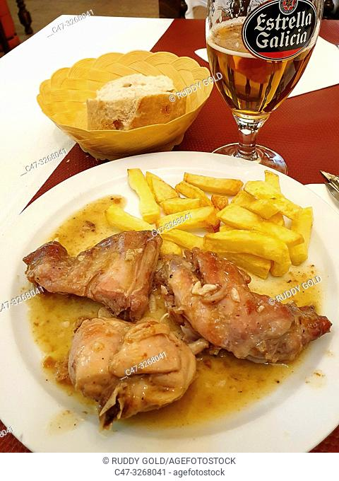 Rabbit stew mediterranean style with french fries