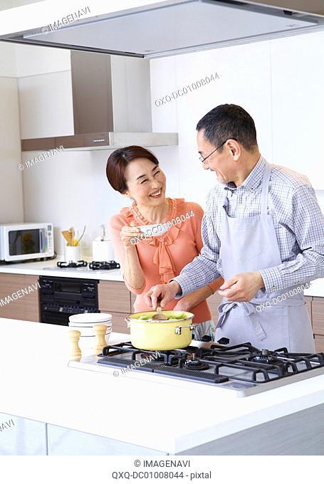 Senior couple enjoying cooking