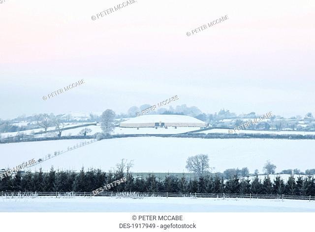 ancient burial mound newgrange in winter, boyne valley, county meath, ireland