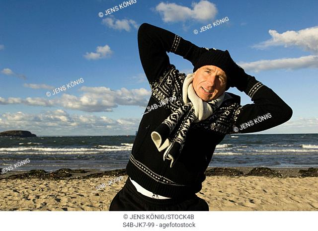 Mature man exercising at beach, Timmendorfer Strand, Schleswig-Holstein, Germany