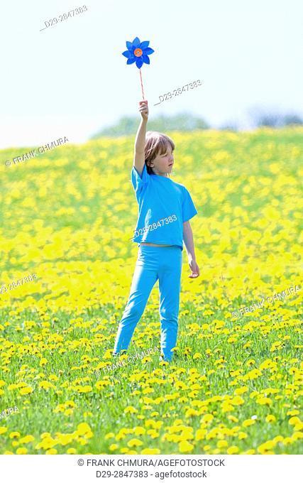 Boy with Pinwheel in a Meadow of Dandelions