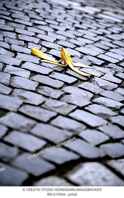 Banana peel on cobblestones, symbol for accident risk