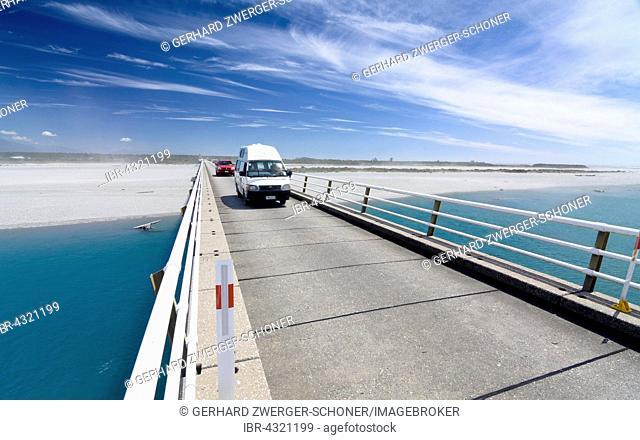Caravan travels over Haast River Bridge, longest lane bridge in New Zealand, West Coast, South Island, New Zealand
