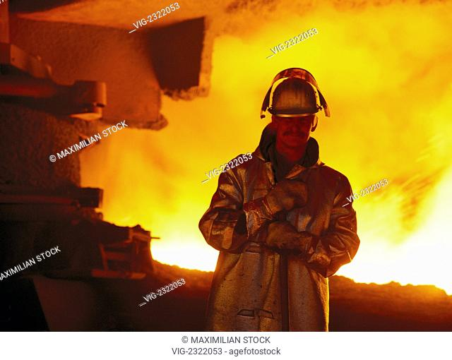 STEEL PRODUCTION. STEEL WORKER WITH SAFETY CLOTHING AT THE BLAST FURNACE - 01/01/2010
