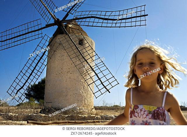 Funy girl in the windmill, Formentera, Balearic Islands, Spain. Old Windmill in el Pilar de la Mola on the island Formentera, Balearic Islands, Spain