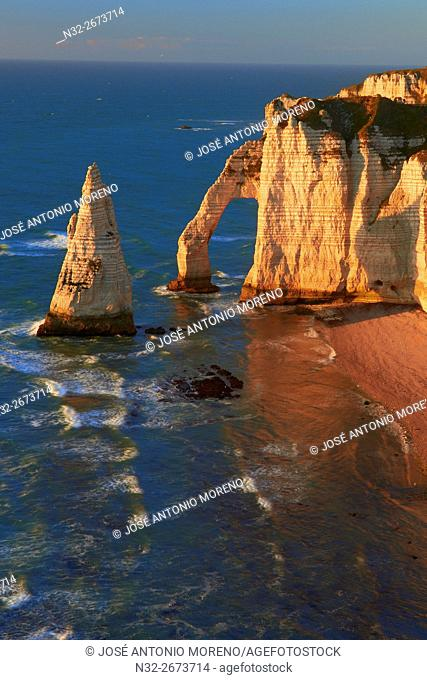 Etretat, Aval cliff , Falaise d'Aval, Natural Arch and Stone Beach, Normandy, Sunset, Seine Maritime, Upper Normandy, Haute Normandie, France