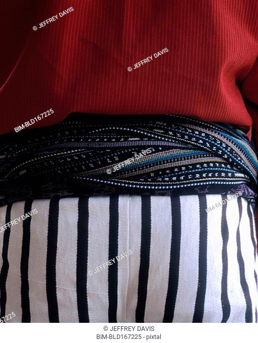 Close up of midsection of person wearing traditional clothing