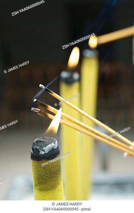 Lighting incense, close-up