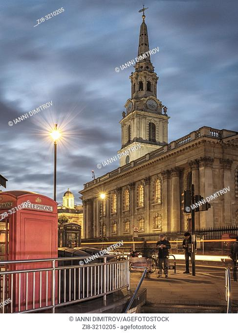 Westminster, London- St Martin-in the-Fields Church and red telephone boxes shot from the Strand exit of Charing Cross underground station