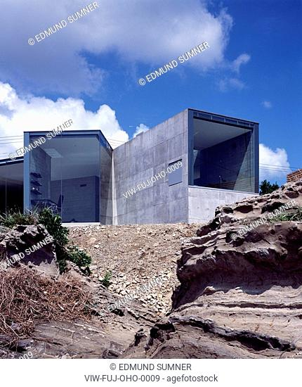 THE O HOUSE EXTERIOR LOW LEVEL VIEW FROM VOLCANIC ROCK FORMATION