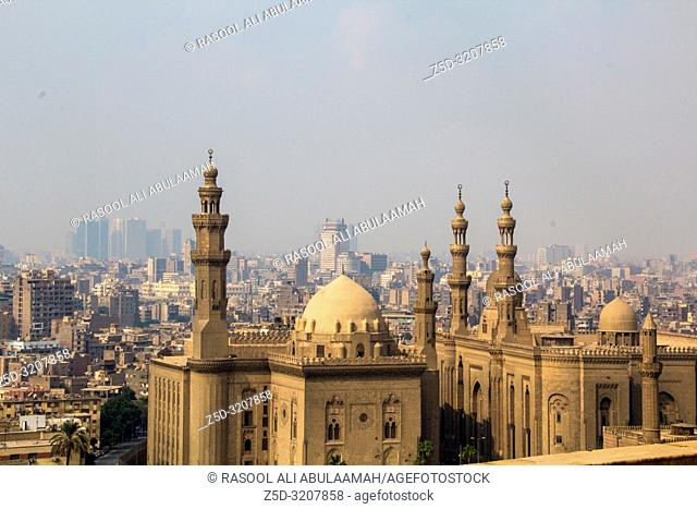 Cairo, Egypt – November 12, 2018: Image from the top of the city of Cairo, the capital of Egypt, And it's showing some residential buildings and Sultan Hassan...