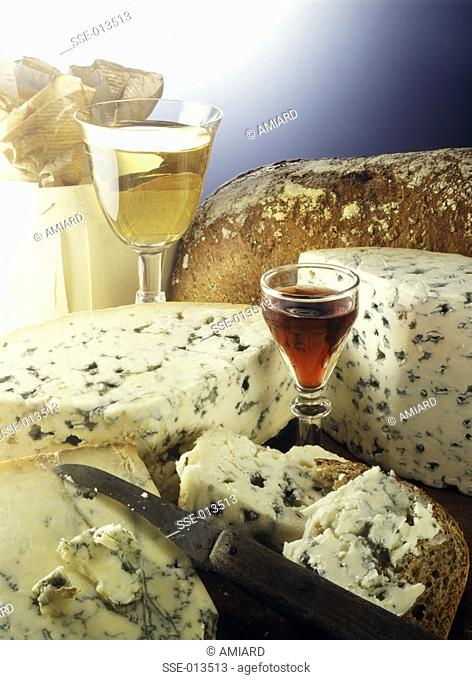 Selection of Roquefort and blue cheeses with a glass of Porto and white wine and bread