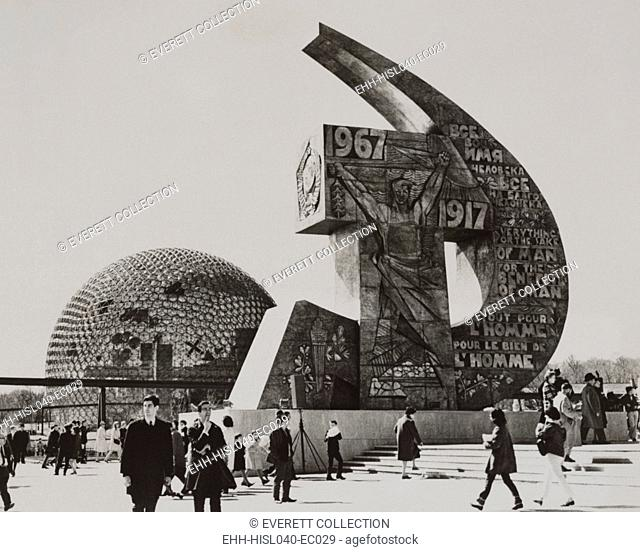 Soviet and U.S. exhibits at the Montreal World's Fair, May 2, 1967. The Soviet Pavilion is a distinctive hammer and sickle monument with expressive art work and...