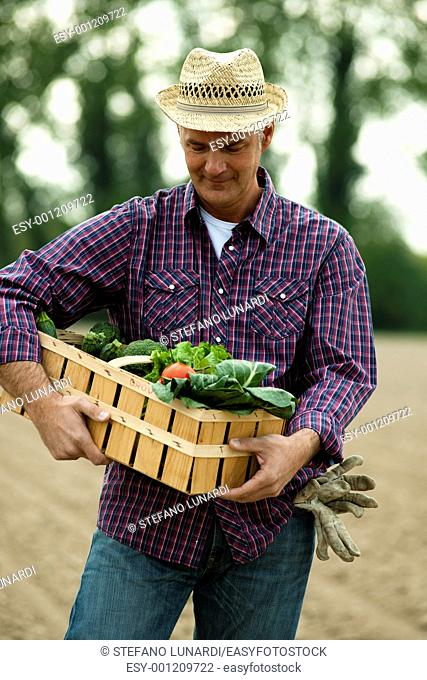 Farmer carrying a crate of vegetables