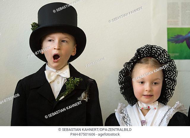Children of the nursery 'Ostro' wear Sorbian wedding costumes on the occasion of the 'Vogelhochzeit' (lit. 'Bird Wedding') festivity in Ostro, Germany