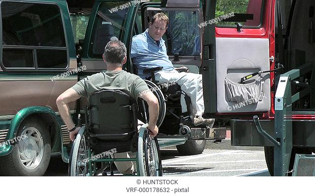 Two men with spinal cord injuries, exiting accessible van