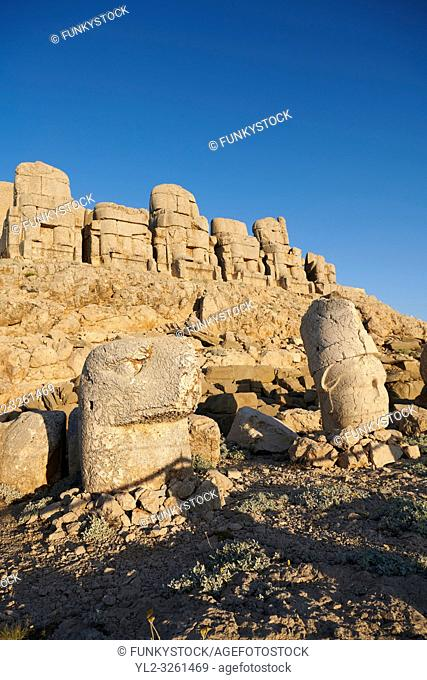 Statue heads, from left, Eagle & Antiochus with headless seated statues in front of the stone pyramid 62 BC Royal Tomb of King Antiochus I Theos of Commagene
