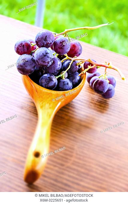 Grapes on a wooden spoon