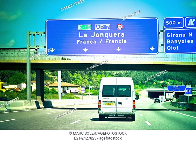 Arrival highway sign to La Jonquera before passing the border between Spain and France. La Jonquera, Catalonia, Spain