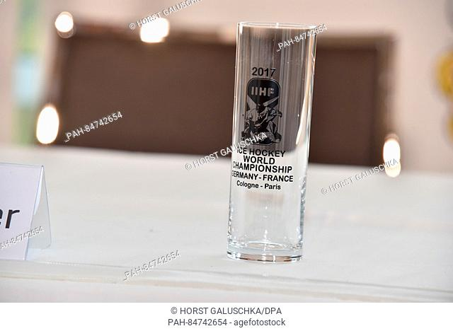 An empty Kolsch beer glass with an advertisement for the World Championship at the official opening press conference for the 2017 IIHF Ice Hockey World...
