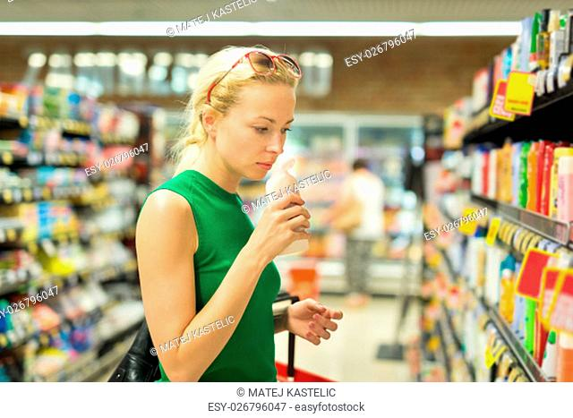 Beautiful caucasian woman shopping personal hygiene products at supermarket