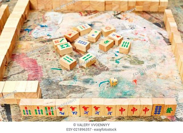 playing in mahjong desk game by wooden tiles