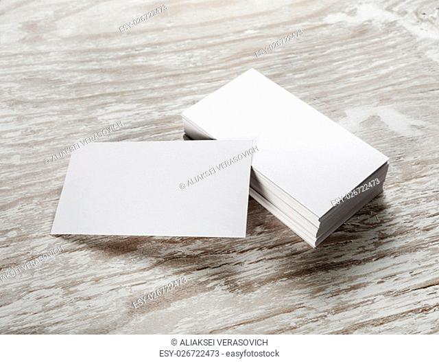 Blank business cards on wooden background. Template for branding identity